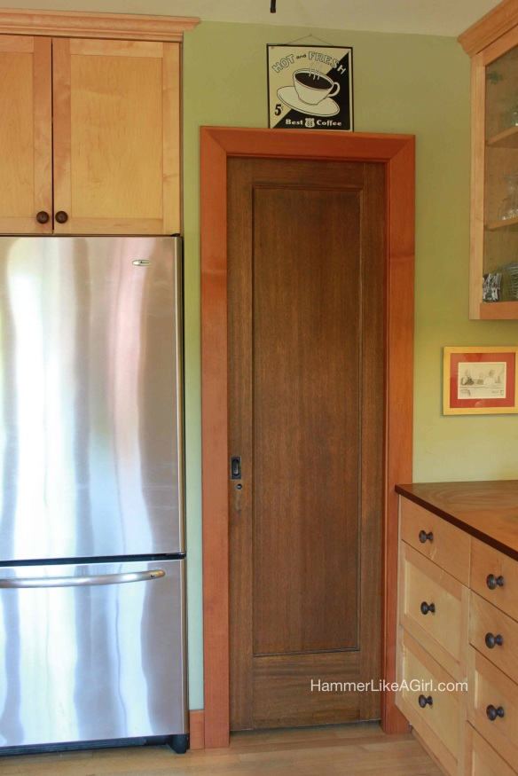 Mahogany door is a nod to our home's past, contrasted with the new maple cabinets and modern appliances
