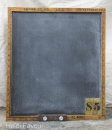 Chalkboard from plywood, brass stencils, old oil company measuring stick.