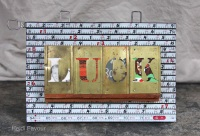 Collage with old measuring tape, brass stencils, ephemera and fir flooring.